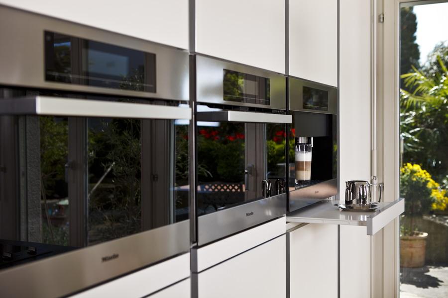 k chen referenz poggenpohl kochinsel mit teppanyaki grill. Black Bedroom Furniture Sets. Home Design Ideas